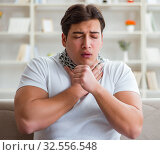 Young man suffering from sore throat. Стоковое фото, фотограф Elnur / Фотобанк Лори