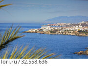 Nerja, Costa del Sol, Malaga Province, Andalusia, southern Spain. View from near Maro to Nerja with the lighthouse of Torrox Costa visible behind. Стоковое фото, фотограф Ken Welsh / age Fotostock / Фотобанк Лори