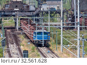 Купить «German train transporting brown coals from Hambach open pit mine to power plant», фото № 32561628, снято 4 июля 2020 г. (c) easy Fotostock / Фотобанк Лори