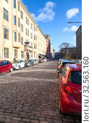 Купить «Paved roads are in central parts of city. Typical downtown with low storey living houses. Helsinki is the capital and most populous city of Finland», фото № 32563160, снято 30 октября 2019 г. (c) Кекяляйнен Андрей / Фотобанк Лори