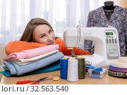 Seamstress woman next to her equipment. Стоковое фото, фотограф Евгений Харитонов / Фотобанк Лори