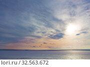 Купить «Sunset over the lake covered with ice», фото № 32563672, снято 19 марта 2016 г. (c) Юрий Бизгаймер / Фотобанк Лори