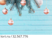 Купить «Christmas balls on fir branches on blue wooden background», фото № 32567776, снято 30 ноября 2019 г. (c) Майя Крученкова / Фотобанк Лори