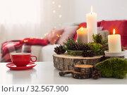 Купить «cup of tea with burning candles on white table», фото № 32567900, снято 3 декабря 2019 г. (c) Майя Крученкова / Фотобанк Лори