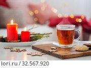 Купить «cup of tea with burning candles at home», фото № 32567920, снято 3 декабря 2019 г. (c) Майя Крученкова / Фотобанк Лори