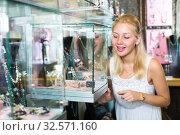 Купить «young woman in bijouterie store», фото № 32571160, снято 10 декабря 2019 г. (c) Яков Филимонов / Фотобанк Лори