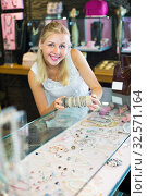 Woman buying bracelet in store. Стоковое фото, фотограф Яков Филимонов / Фотобанк Лори