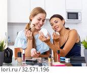 Two modern girls applying make up. Стоковое фото, фотограф Яков Филимонов / Фотобанк Лори