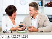 Купить «Mother and son with smartphones», фото № 32571220, снято 8 июля 2020 г. (c) Яков Филимонов / Фотобанк Лори