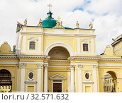 Купить «The facade of Catholic Church of St Catherine with monumental arched portal on self-supporting columns and the massive cupola», фото № 32571632, снято 24 февраля 2020 г. (c) Николай Коржов / Фотобанк Лори