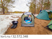 Купить «An elderly man Tourist lies in a tent, in the forest early spring.», фото № 32572348, снято 9 апреля 2017 г. (c) Акиньшин Владимир / Фотобанк Лори