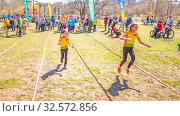 Купить «Russia, Samara, April 2017: children's relay race, together with their parents for the opening of the bike season in the city park on a spring sunny day.», фото № 32572856, снято 29 апреля 2017 г. (c) Акиньшин Владимир / Фотобанк Лори