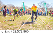 Купить «Russia, Samara, April 2017: children's relay race, together with their parents for the opening of the bike season in the city park on a spring sunny day.», фото № 32572860, снято 29 апреля 2017 г. (c) Акиньшин Владимир / Фотобанк Лори