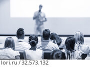 Купить «Male business speaker giving a talk at business conference event.», фото № 32573132, снято 15 июня 2018 г. (c) Matej Kastelic / Фотобанк Лори
