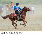 Купить «Kok Boru (Buzkashi), traditional equestrian team sport. Festival on the Suusamyr plain commemorating Mr Koshkomul, a sportsman and folk hero of the last...», фото № 32576924, снято 29 июня 2019 г. (c) age Fotostock / Фотобанк Лори