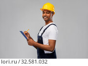 Купить «happy builder in helmet with clipboard and pencil», фото № 32581032, снято 17 ноября 2019 г. (c) Syda Productions / Фотобанк Лори