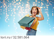 Купить «happy smiling young woman with shopping bags», фото № 32581064, снято 30 сентября 2019 г. (c) Syda Productions / Фотобанк Лори