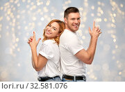 Купить «couple in white t-shirts shirts making gun gesture», фото № 32581076, снято 6 октября 2019 г. (c) Syda Productions / Фотобанк Лори