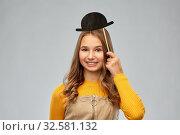 smiling teenage girl with black vintage bowler hat. Стоковое фото, фотограф Syda Productions / Фотобанк Лори