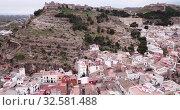 Купить «Aerial view of Sagunto city and antique roman fortress, Valencia, Spain», видеоролик № 32581488, снято 19 марта 2019 г. (c) Яков Филимонов / Фотобанк Лори