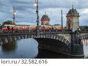 Купить «Evening at Legions Bridge in Prague, Vltava.», фото № 32582616, снято 25 сентября 2019 г. (c) age Fotostock / Фотобанк Лори