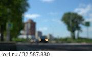 Купить «Car rides on road. Blurred background. Close up shot. Summer day, car traffic in provincial town», видеоролик № 32587880, снято 20 августа 2018 г. (c) Dmitry Domashenko / Фотобанк Лори