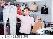 Купить «Young female is choosing new jeans», фото № 32588308, снято 7 февраля 2017 г. (c) Яков Филимонов / Фотобанк Лори