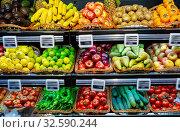 Fruits and vegetables on shelves in supermarket. Стоковое фото, фотограф Яков Филимонов / Фотобанк Лори