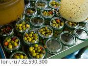 Купить «Open glass jars with olives - preparation for canning», фото № 32590300, снято 10 декабря 2019 г. (c) Яков Филимонов / Фотобанк Лори