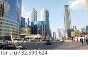 Купить «Doha, Qatar - Nov 18. 2019. Cityscape downtown at Omar Al Mukhtar Street», видеоролик № 32590624, снято 9 декабря 2019 г. (c) Володина Ольга / Фотобанк Лори