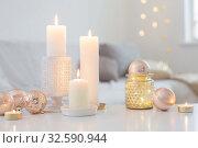 Купить «Christmas decorations with candles at home», фото № 32590944, снято 2 декабря 2019 г. (c) Майя Крученкова / Фотобанк Лори