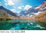 Купить «Beautiful serene lake in Fann mountains (branch of Pamir) in Tajikistan.», фото № 32592384, снято 31 марта 2020 г. (c) easy Fotostock / Фотобанк Лори