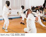 Купить «Mixed age group of athletes at fencing workout», фото № 32600360, снято 30 мая 2018 г. (c) Яков Филимонов / Фотобанк Лори