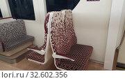 Купить «Doha, Qatar - Nov 20. 2019. The Red line subway car interior», видеоролик № 32602356, снято 9 декабря 2019 г. (c) Володина Ольга / Фотобанк Лори