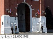 Купить «Военнослужащие роты почетного караула на посту около ворот Спасской башни на Красной площади», фото № 32606948, снято 7 мая 2019 г. (c) Free Wind / Фотобанк Лори