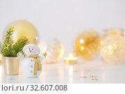 Купить «Christmas decorations with little ceramic snowman», фото № 32607008, снято 29 ноября 2019 г. (c) Майя Крученкова / Фотобанк Лори