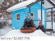 Купить «Happy children sledding», фото № 32607716, снято 1 января 2019 г. (c) Юлия Бабкина / Фотобанк Лори