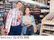 Купить «Woman and girl shopping various supplies», фото № 32615908, снято 12 апреля 2017 г. (c) Яков Филимонов / Фотобанк Лори