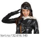 Купить «Portrait of pretty brunette girl in retro pilot costume giving military salute», фото № 32616140, снято 1 декабря 2019 г. (c) Алексей Кузнецов / Фотобанк Лори