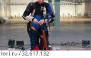 Купить «BULLET SHOOTING. girl is collecting weapons details», видеоролик № 32617132, снято 8 июля 2020 г. (c) Константин Шишкин / Фотобанк Лори