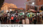 Купить «BARCELONA, SPAIN - DECEMBER 1, 2015:  People  walking at Christmas market near Cathedral in evening. Barcelona, Spain.  Kiosks with Traditional Christmas toys and gifts», видеоролик № 32617216, снято 1 декабря 2015 г. (c) Яков Филимонов / Фотобанк Лори
