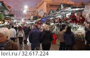 Купить «BARCELONA, SPAIN - DECEMBER 11, 2019: Traditional Christmas fair near Cathedral   in evening. Barcelona, Catalonia.», видеоролик № 32617224, снято 11 декабря 2019 г. (c) Яков Филимонов / Фотобанк Лори