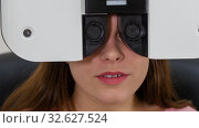Купить «Ophthalmology treatment - a young woman checking her visual acuity with a special optometry equipment - a machine changing lenses», фото № 32627524, снято 15 декабря 2019 г. (c) Константин Шишкин / Фотобанк Лори