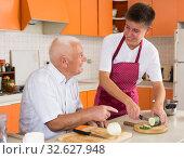 Купить «Senior man and his grandson cooking», фото № 32627948, снято 17 августа 2019 г. (c) Яков Филимонов / Фотобанк Лори