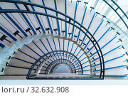 Купить «Helical stairway, simple modern semicircle staircase, view from the top down», фото № 32632908, снято 27 февраля 2020 г. (c) easy Fotostock / Фотобанк Лори