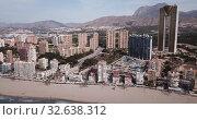 Купить «Aerial view of coast at Benidorm cityscape with a modern apartment buildings, Spain», видеоролик № 32638312, снято 17 апреля 2019 г. (c) Яков Филимонов / Фотобанк Лори