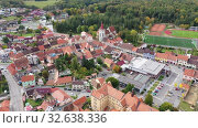 Купить «Aerial view of historical centre of Blatna in autumn day overlooking gothic church bell tower and ancient Water castle, South Bohemian Region, Czech Republic», видеоролик № 32638336, снято 11 октября 2019 г. (c) Яков Филимонов / Фотобанк Лори
