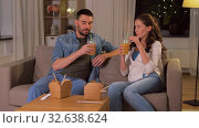 happy couple drinking takeaway juice at home. Стоковое видео, видеограф Syda Productions / Фотобанк Лори