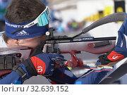Купить «Sportsman biathlete rifle shooting, aiming, reloading rifle in prone position. Biathlete Amirbekov Artem in shooting range. Junior biathlon competitions East of Cup», фото № 32639152, снято 14 апреля 2019 г. (c) А. А. Пирагис / Фотобанк Лори