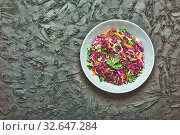 Купить «Salad, healthy food. Red cabbage salad. Fresh vegetable salad with purple cabbage, white cabbage, salad, carrot in a dark clay bowl on a black background. View from above», фото № 32647284, снято 5 июля 2020 г. (c) easy Fotostock / Фотобанк Лори
